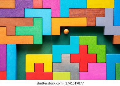 The concept of a business strategy, analytics, search for solutions, the search output. Labyrinth of colorful wooden blocks. People in the maze, finding a way out. The man in the maze.