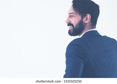 concept of business success - businessman standing back to camer