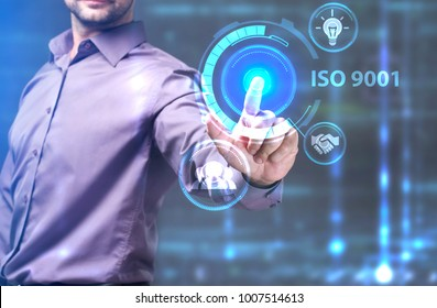 The concept of business, technology, the Internet and the network. A young entrepreneur working on a virtual screen of the future and sees the inscription: ISO 9001