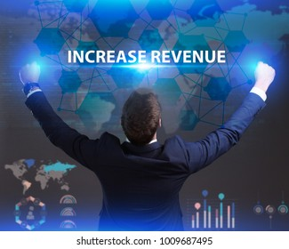 The concept of business, technology, the Internet and the network. Young businessman showing inscription: Increase revenue