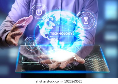 The concept of business, technology, the Internet and the network. A young entrepreneur working on a virtual screen of the future and sees the inscription: Technology