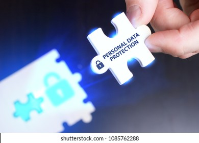 The concept of business, technology, the Internet and the network. A young businessman collects a puzzle with the proper inscription: Personal data protection