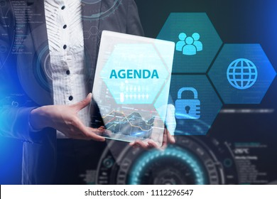 The concept of business, technology, the Internet and the network. A young entrepreneur working on a virtual screen of the future and sees the inscription: Agenda