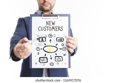 The concept of business, technology, the Internet and the network. A young businessman shows a successful scheme of work: New customers
