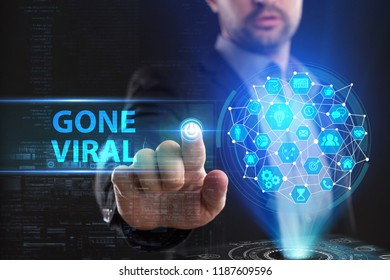 The concept of business, technology, the Internet and the network. A young entrepreneur working on a virtual screen of the future and sees the inscription: Gone viral