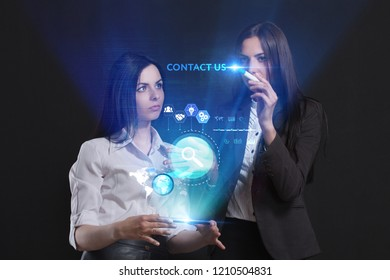The concept of business, technology, the Internet and the network. A team of business women working on the virtual screen of the future and see the inscription: Contact us