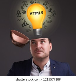 The concept of business, technology, the Internet and the network. A young businessman thinks about the work process: HTML5
