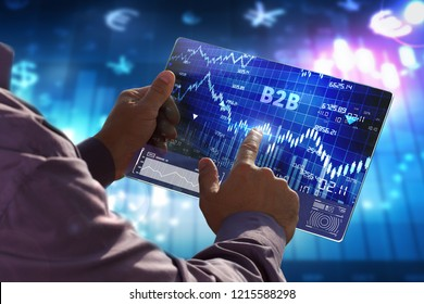 The concept of business, technology, the Internet and the network. A young entrepreneur working on a virtual screen of the future and sees the inscription: B2B