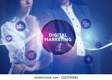 The concept of business, technology, the Internet and the network. A team of business women working on the virtual screen of the future and see the inscription: Digital Marketing