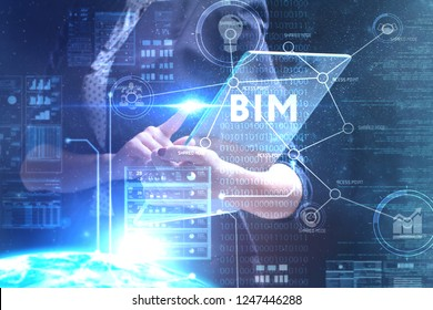 The concept of business, technology, the Internet and the network. A young entrepreneur working on a virtual screen of the future and sees the inscription: BIM