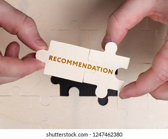 The concept of business, technology, the Internet and the network. A young businessman collects a puzzle with the proper inscription: Recommendation