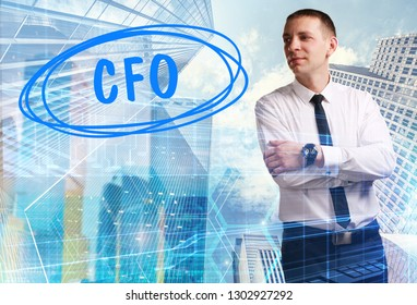 The concept of business, technology, the Internet and the network. Young businessman showing inscription: CFO