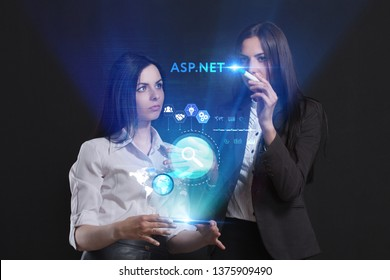 The concept of business, technology, the Internet and the network. A team of business women working on the virtual screen of the future and see the inscription: ASP.NET