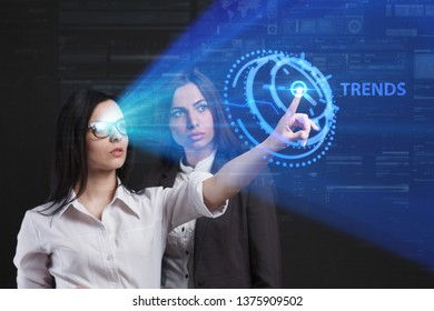 The concept of business, technology, the Internet and the network. A team of business women working on the virtual screen of the future and see the inscription: Trends