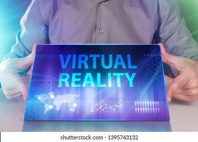 The concept of business, technology, the Internet and the network. A young entrepreneur working on a virtual screen of the future and sees the inscription: Virtual reality