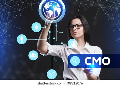 The concept of business, technology, the Internet and the network. A young entrepreneur working on a virtual screen of the future and sees the inscription: CMO
