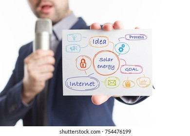 The concept of business, technology, the Internet and the network. Young businessman showing inscription: Solar energy