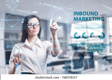 The concept of business, technology, the Internet and the network. A young entrepreneur working on a virtual screen of the future and sees the inscription: Inbound marketing