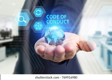 The concept of business, technology, the Internet and the network. A young entrepreneur working on a virtual screen of the future and sees the inscription: Code of conduct