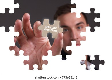 The concept of business, technology, the Internet and the network. A young businessman collects a puzzle with the proper inscription: Affiliate marketing