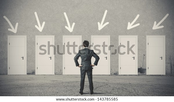 Concept of businessman choosing the right door