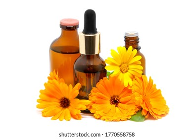Concept of calendula flower essential oil, extract and tincture - beauty treatment.