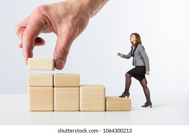 The concept of career development. Business woman rises on the stage of your career.