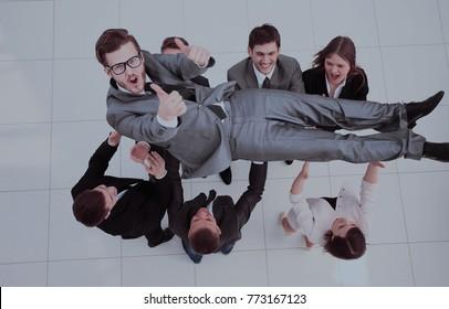 concept of celebrating success.happy business team smiling, shak
