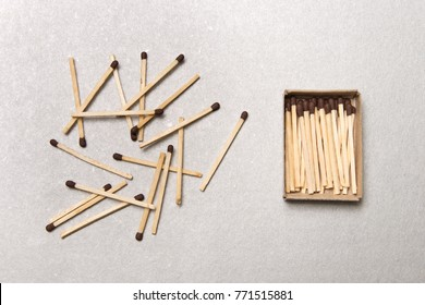 The concept of chaos and order. Chaotic match boxes lying around with the order of stacked matches