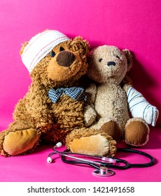 concept of child playing doctor with teddy bears and bandage with a stethoscope for education to healthcare or hospital over pink background