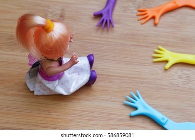 Concept of a child represented by a doll refusing or showing a sign to stop hands from reaching her. Concept of abuse, harassment, exploitation,pornography and child trafficking.
