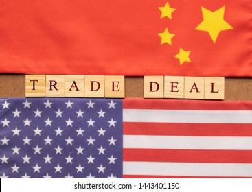 Concept of China US Trade deal, Trade Deal Printed on Wooden block letters in between China and US Flags.