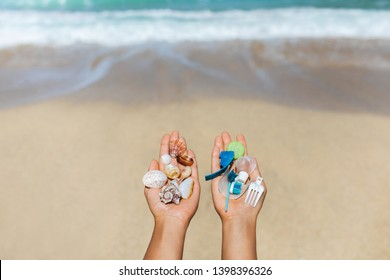 Concept of choice: save nature or continue to use disposable plastic. One hand holding beautiful shells, in the other - plastic waste. Ocean and tropical beach on background. Environmental pollution.