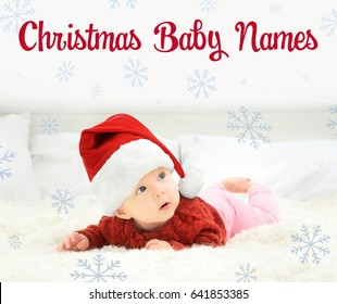 Concept of choosing Christmas baby names. Little child in Santa hat lying on bed