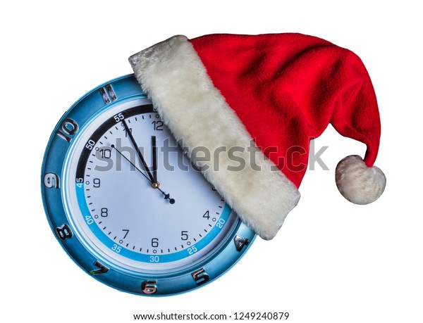 Concept: Christmas and New Year. Santa's hat is worn on a wall clock and the arrows show the approaching New Year's midnight on white background, golden falling snow