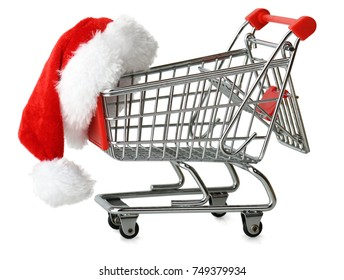 Concept of christmas shopping with santa hat on a shopping cart isolated on a white background