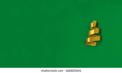 Concept Christmas tree on green background stock photo. Christmas tree made of gold scotch tape