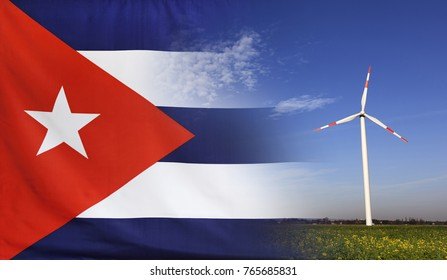 Concept clean energy with flag of Cuba merged with wind turbine in a blue sunny sky and green grass with flowers