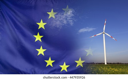 Concept clean energy with flag of Europe merged with wind turbine in a blue sunny sky and green grass with flowers