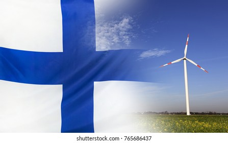Concept clean energy with flag of Finland merged with wind turbine in a blue sunny sky and green grass with flowers