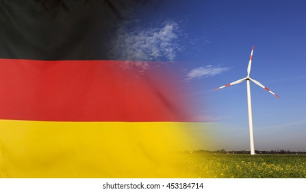 Concept clean energy with flag of Germany merged with wind turbine in a blue sunny sky and green grass with flowers