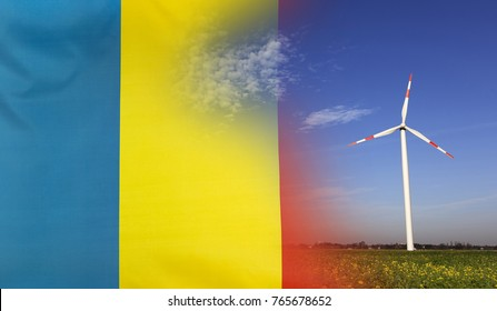 Concept clean energy with flag of Romania merged with wind turbine in a blue sunny sky and green grass with flowers