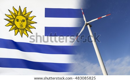 Concept clean energy with flag of Uruguay merged with wind turbine in a blue sunny sky