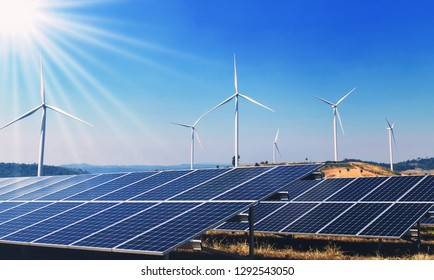 concept clean energy power in nature. solar panels and wind turbine on hill