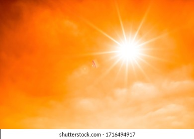 Concept for climate change or global warming, orange sky with with clouds and bright sun