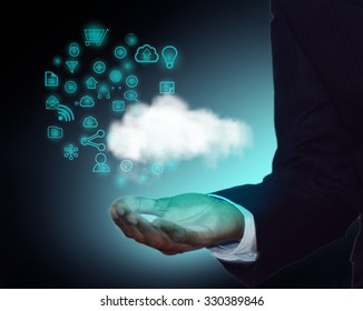 Concept of Cloud computing, Business man demonstrating cloud application development with icon collection