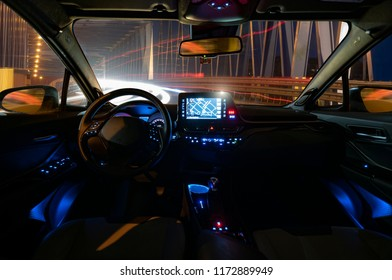 concept of the cockpit of an autonomous car driving at night illuminated by a tunnel