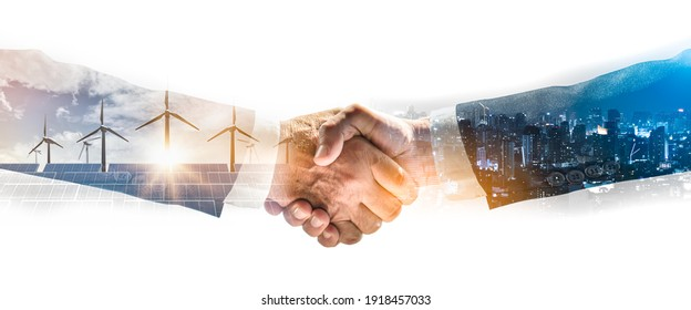 Concept of collaboration to change the world to reduce global warming,energy sources for renewable,sustainability by alternative energy.Double exposure of handshake of wind turbine and night city. - Shutterstock ID 1918457033
