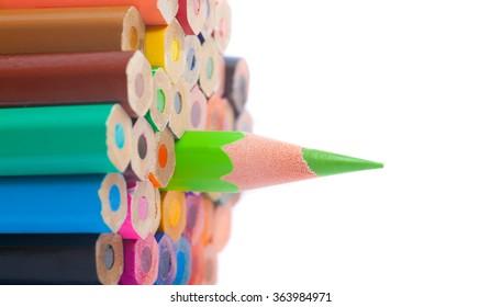Concept, color pencils - closeup, macro shot - on white background