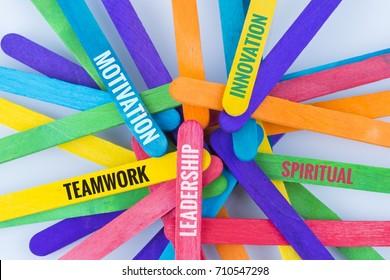 Concept colorful ice cream stick with word TEAMWORK, LEADERSHIP, MOTIVATION,  INNOVATION, SPIRITUAL